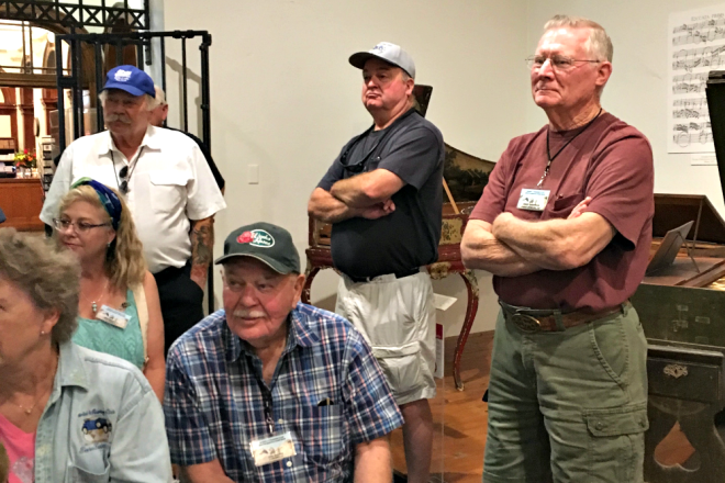 Tour-goers listen at Vermilion's National Music Museum.