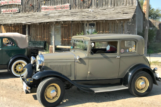 Model A's and rustic building close-up. Photo by Snuttjer.